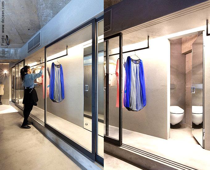 Mas o grande diferencial do projeto é o extenso corredor com closet ambiente, separado da circulação por portas de vidro.
